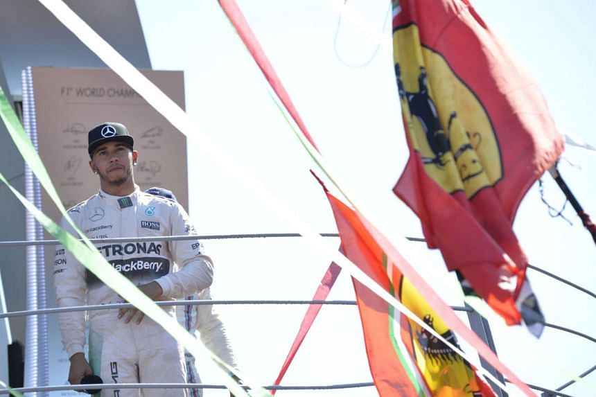 Lewis Hamilton stands on the podium after winning the Italian Formula One Grand Prix on Sept 6, 2015.