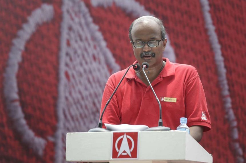 SDP's Holland-Bukit Timah GRC candidate Paul Tambyah speaking during a lunchtime rally at UOB Plaza promenade on Sept 7.