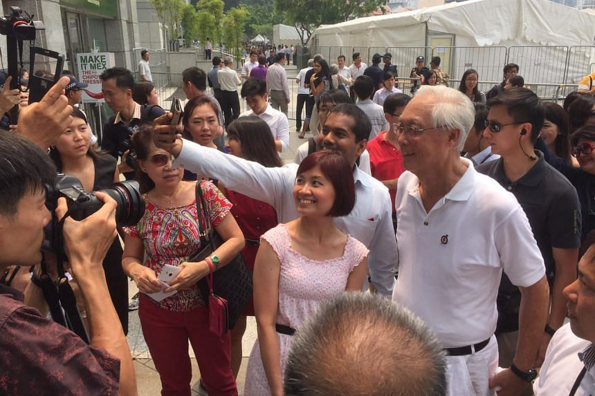 People having a selfie taken with ESM Goh after the PAP lunchtime rally at UOB Plaza promenade on Sept 8, 2015.