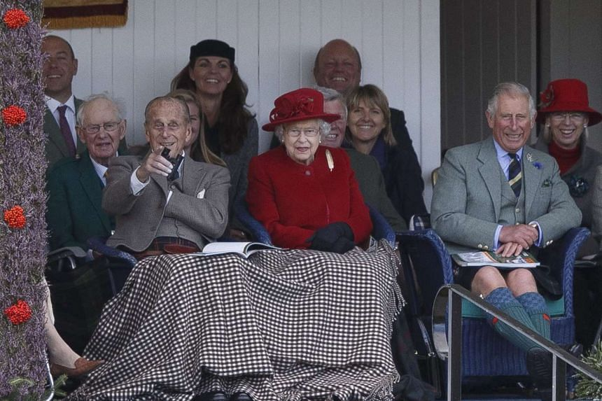 Britain's Queen Elizabeth II (centre), her husband Prince Philip, Duke of Edinburgh (left), and son Prince Charles (right) attend the Braemar Gathering at The Princess Royal and Duke of Fife Memorial Park, in Braemar, Scotland on Saturday.