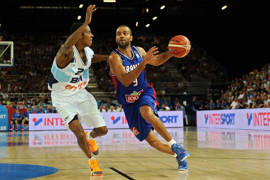 France's point guard Tony Parker (right) dribbles past Bosnia and Herzegovina's Alex Renfroe at the EuroBasket 2015 in Montpellier on Sunday.