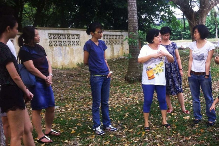 """Animal lover Lesley Ong (centre in white T-shirt) shares charming stories of the """"backyard"""" of her house in Yio Chu Kang."""