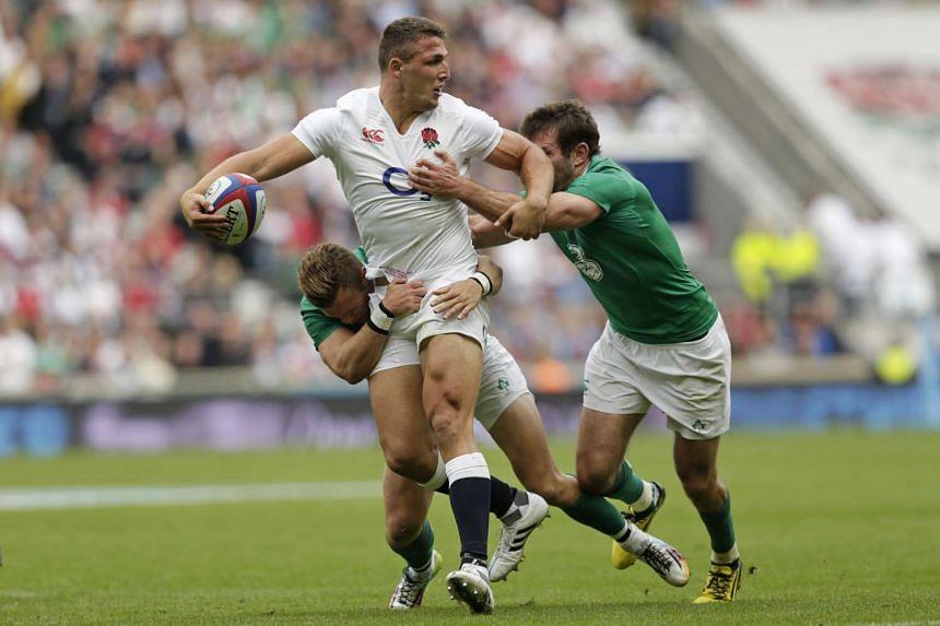 England, with Sam Burgess (in white) in action against Ireland, extended their streak of home wins to seven with a 21-13 triumph.
