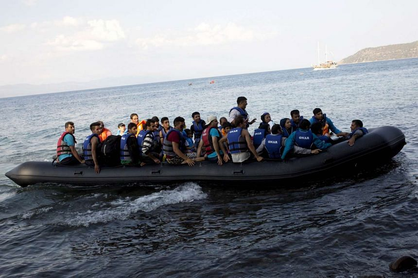 Syrian refugees arrive on the shores of the Greek island of Lesbos from across the Aegean Sea aboard an inflatable raft on Sept 8, 2015.