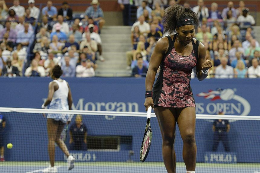 Serena Williams (right) reacts as she plays her sister, Venus Williams during their quarterfinals match at the 2015 US Open Tennis Championship.