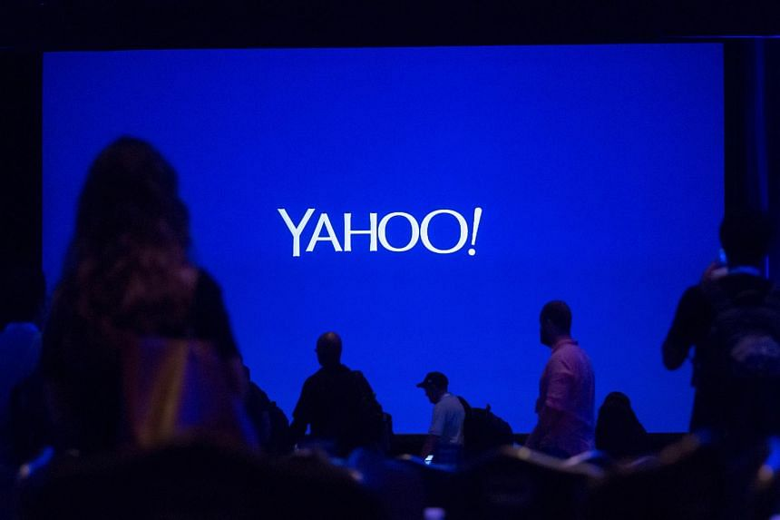 The silhouettes of attendees are seen before the start of the Yahoo! Inc. Mobile Developer Conference in New York, US, on Aug 26, 2015.