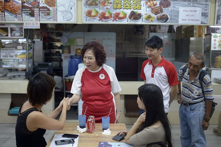 SPP candidate Lina Chiam (second from left) meeting patrons and residents at a coffeeshop in Potong Pasir on Sept 7, 2015.