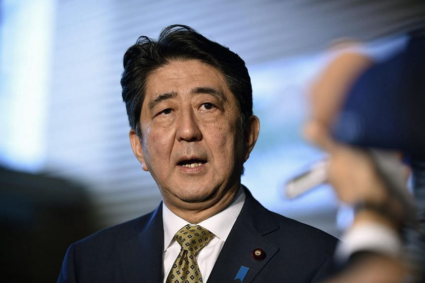 Japanese Prime Minister Shinzo Abe speaking to reporters at his official residence in Tokyo on Sept 8, 2015.