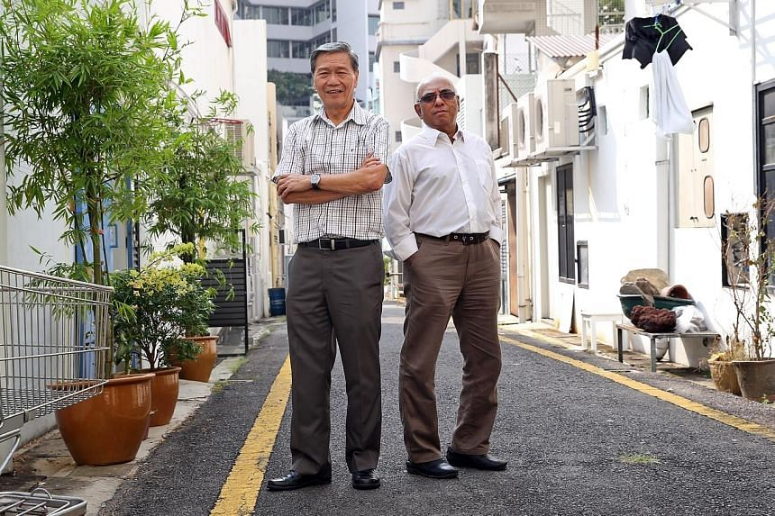 Mr Lee and Mr Kandasamy joined the CNB in 1972, when drug abuse was rampant and officers used public telephones.