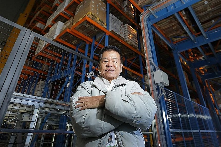 Mr Liew Yew Fah at the firm's warehouse in Mandai Link. The facility is automated so as to reduce the manpower needs of the company. It also makes better use of space so more products can be stored there.