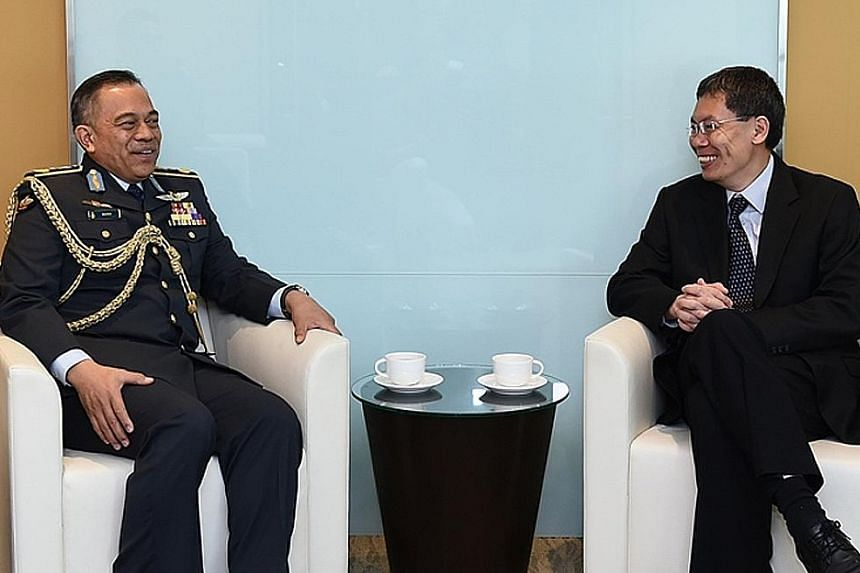 Commander of the Royal Brunei Air Force, Brigadier- General (U) Dato Seri Pahlawan Haji Wardi bin Haji Abdul Latip (left), with Second Minister for Defence Lui Tuck Yew at the Ministry of Transport yesterday morning. The general's three-day visit end