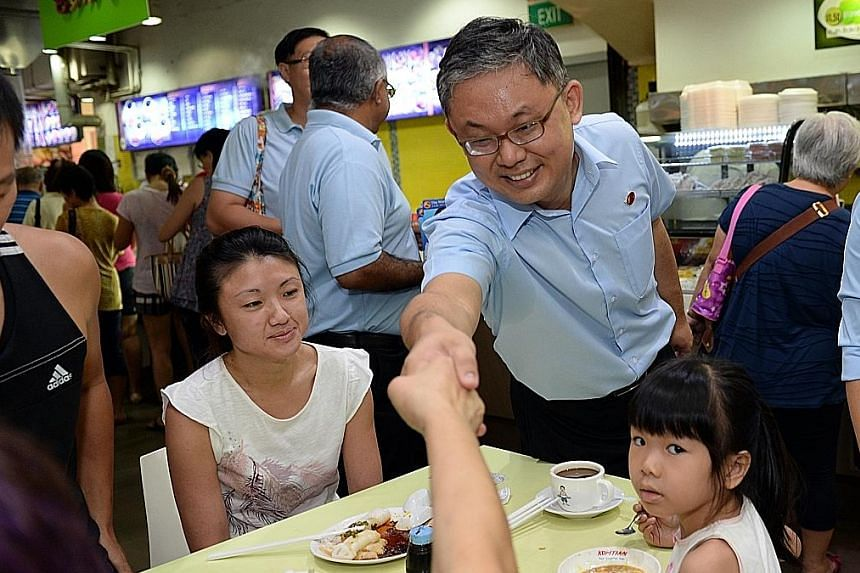 Mr Koh Choong Yong of the Workers' Party shaking the hand of a resident during a walkabout in Sengkang on Sunday. Dr Lam Pin Min of the People's Action Party visiting an Anchorvale resident during a walkabout in the ward last Saturday.
