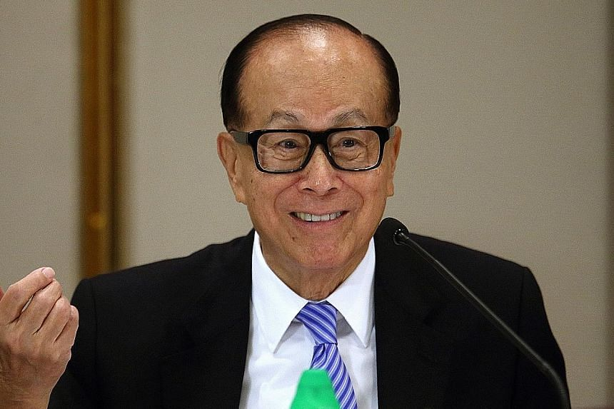 Mr Li Ka Shing is reshuffling his business empire for the second time this year as he seeks fresh acquisitions.