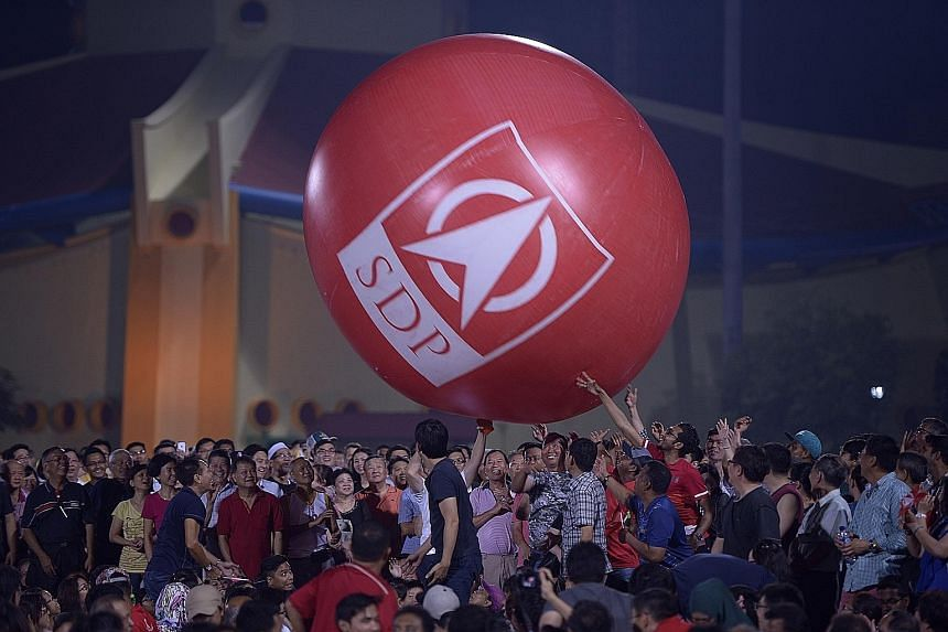 A giant Singapore Democratic Party inflatable ball got the crowd involved at last night's party rally at Woodlands Stadium.