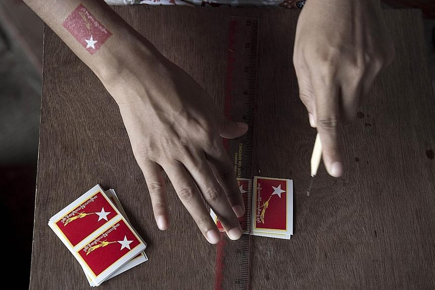 The symbols used by Myanmar's political parties are seen as logos laced with meaning but fraught with potential confusion.