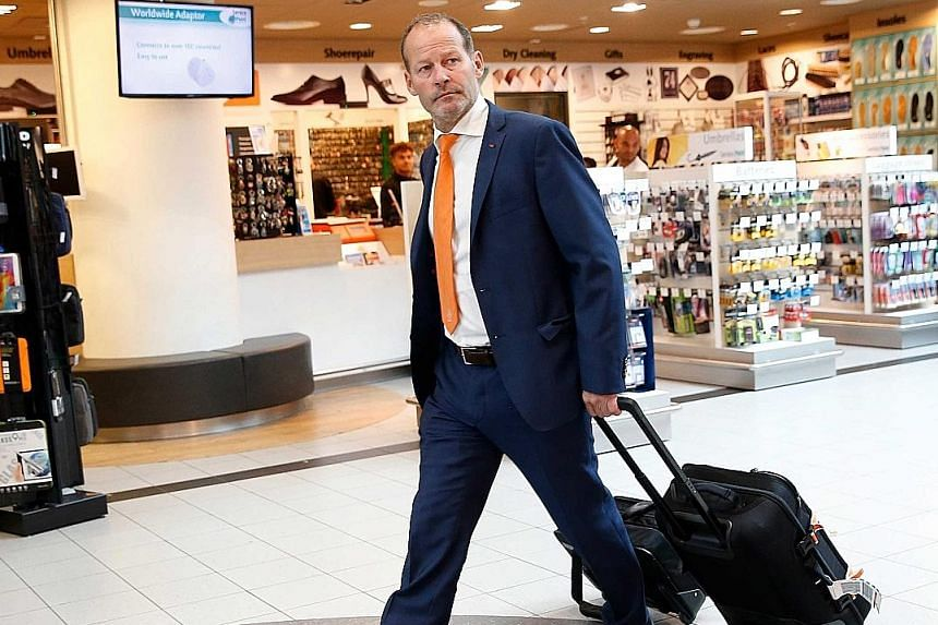Danny Blind, head coach of the Dutch national soccer team, arrives at Schiphol airport in Amsterdam after the Netherlands' surprise 0-1 loss to Iceland last week.