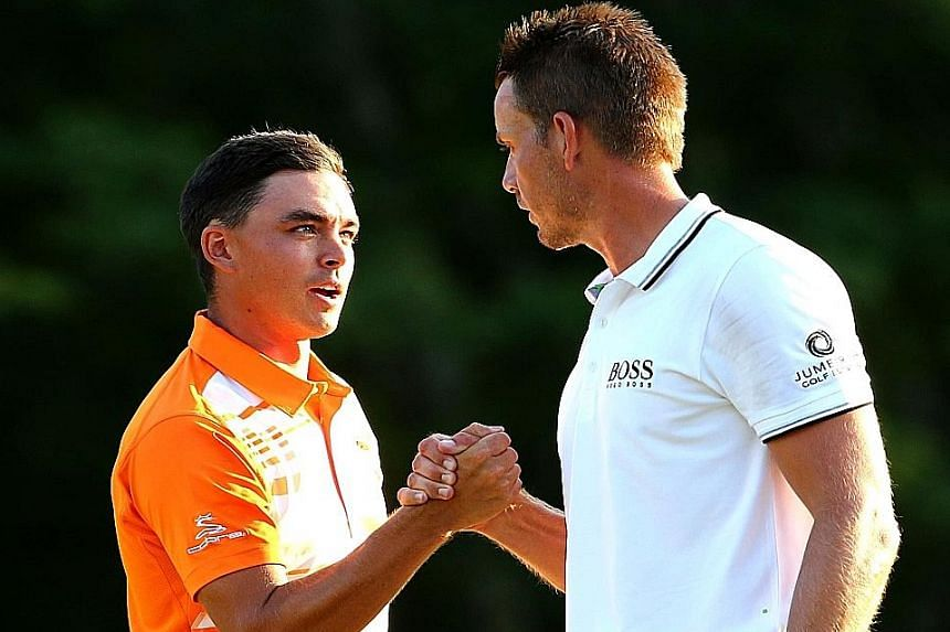 Rickie Fowler (left) being congratulated by Henrik Stenson after he won the Deutsche Bank Championship by one stroke. The American claimed his third PGA Tour title and moved to fifth in the world rankings.