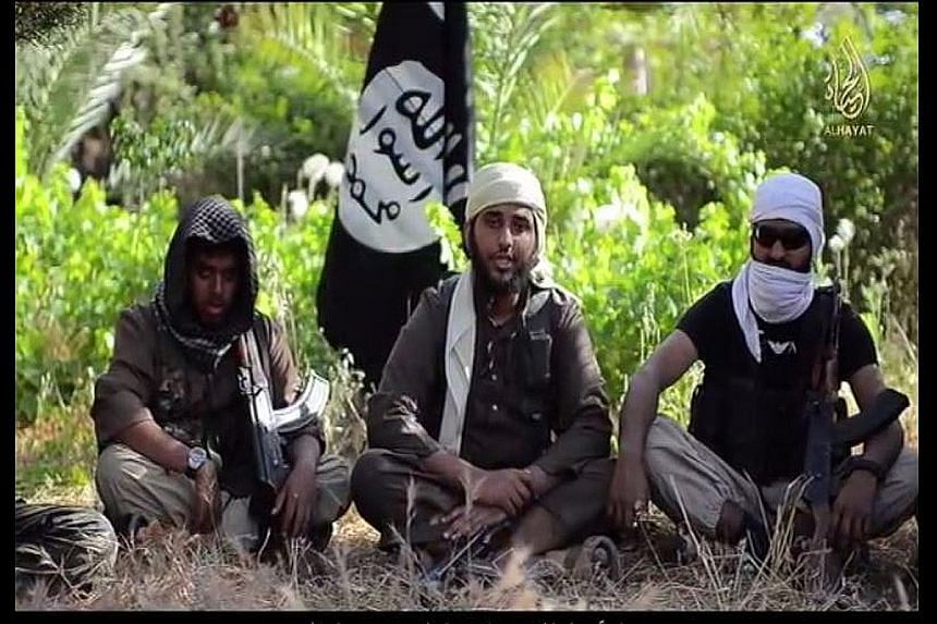 British ISIS militants Reyaad Khan (left) and Ruhul Amin (right) pictured here in a screengrab from an ISIS propaganda video. They were both killed in Britain's first air strike against Syria last month, British Prime Minister David Cameron announced