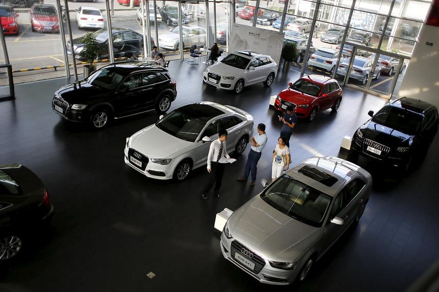 Customers looking at cars in an Audi dealership in Shanghai on Sept 2, 2014.