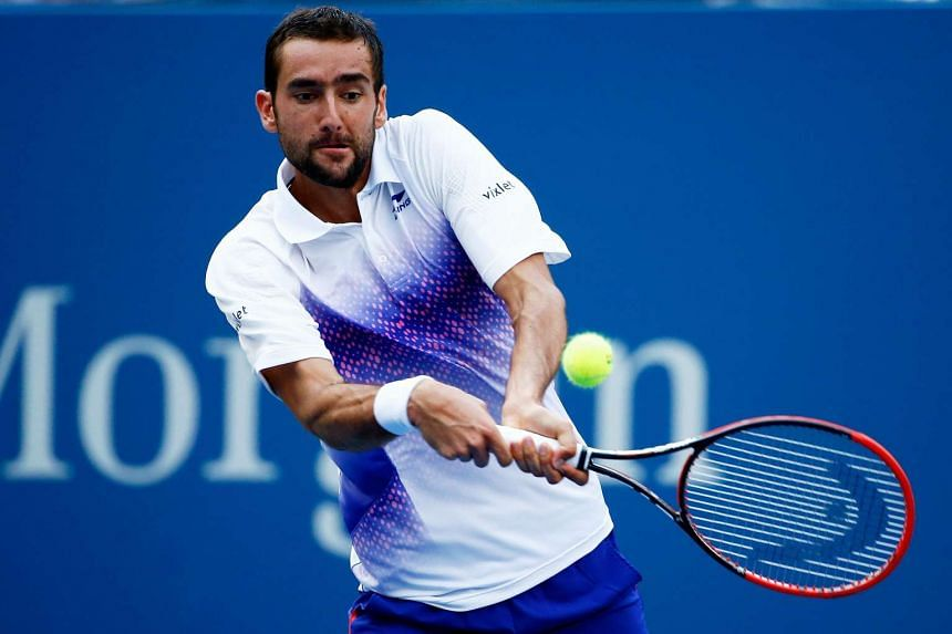 Marin Cilic of Croatia returns a shot to Jo-Wilfried Tsonga of France during their Men's Singles Quarterfinals match on Day 9 of the 2015 US Open at the USTA Billie Jean King National Tennis Center on Sept 8, 2015.
