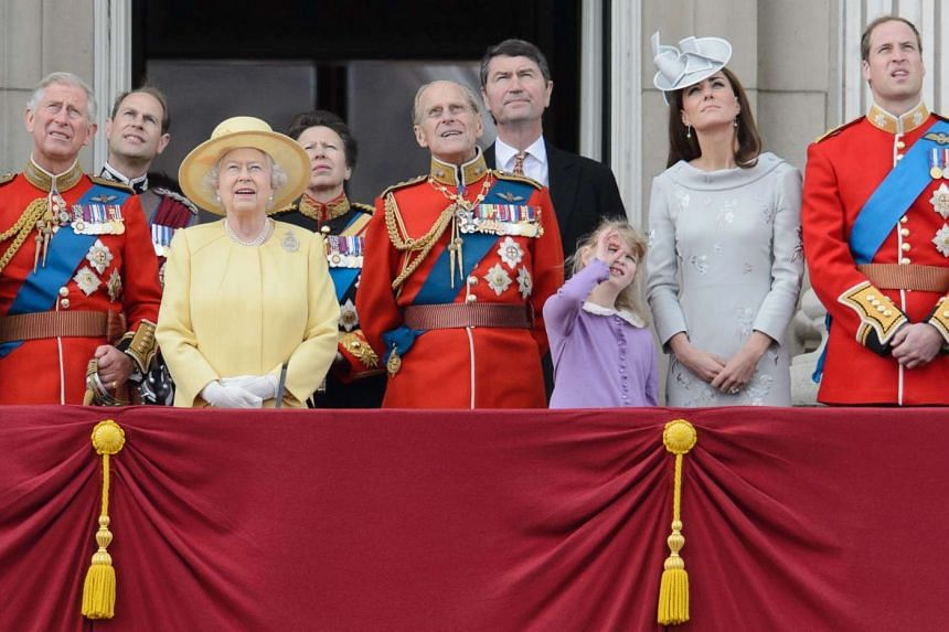 Britain's Queen Elizabeth II (third from left) and other members of the British royal family watching a fly-past from the balcony of Buckingham Palace in London following the Queen's Birthday Parade.