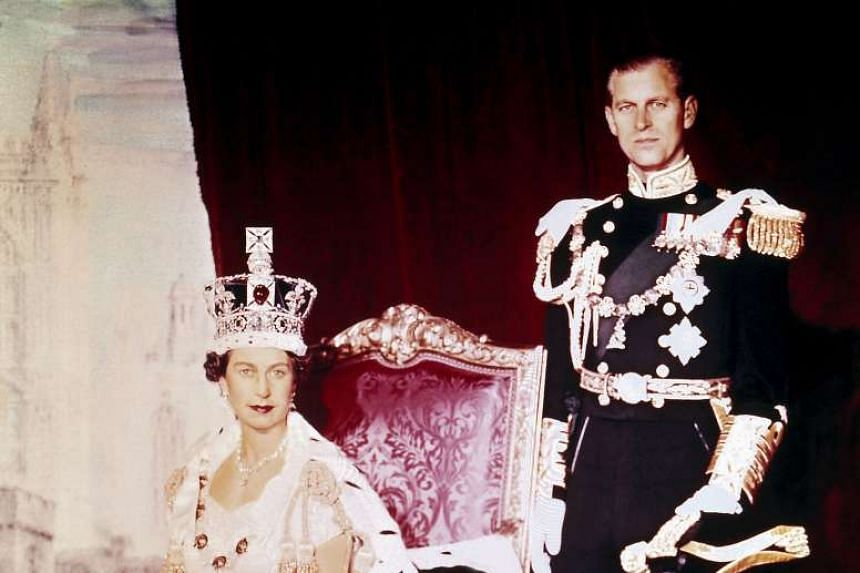 Britain's Queen Elizabeth II and her husband Prince Philip posing for photos on the Queen's Coronation day at Buckingham Palace.