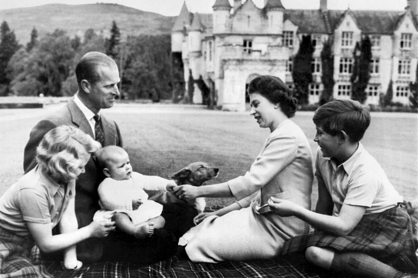 Queen Elizabeth II and her husband Prince Philip with their children Princess Anne (left), Prince Charles (right) and Prince Andrew at Balmoral in Scotland.