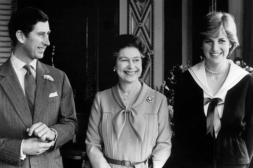 Queen Elizabeth II (centre) with her son Prince Charles and his then fiancee Lady Diana at Buckingham Palace in London.