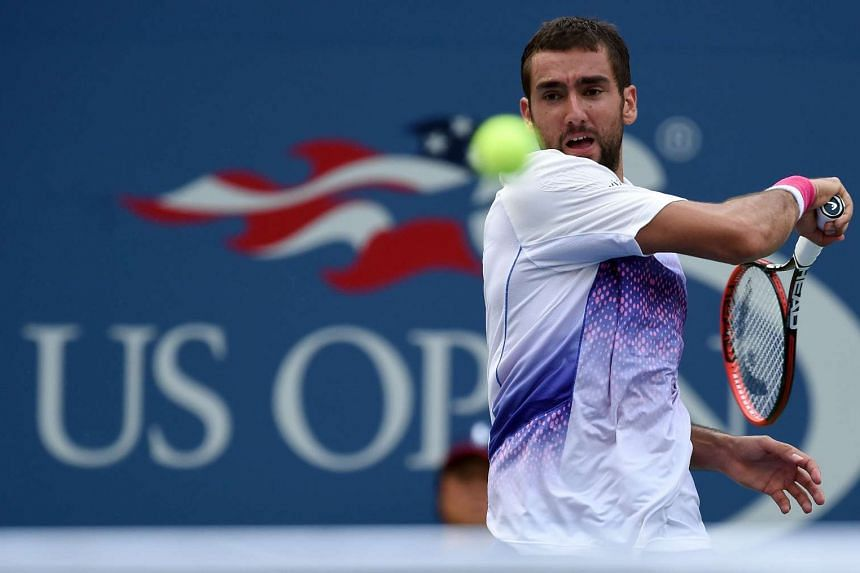 Marin Cilic returns the ball to Jo-Wilfried Tsonga during their 2015 US Open Men's singles quarterfinals match.