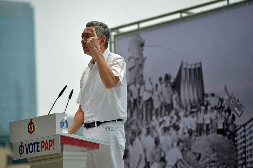 Prime Minister Lee Hsien Loong speaking at a People's Action Party (PAP) lunchtime rally held at the Promenade area beside UOB Plaza on September 8, 2015.
