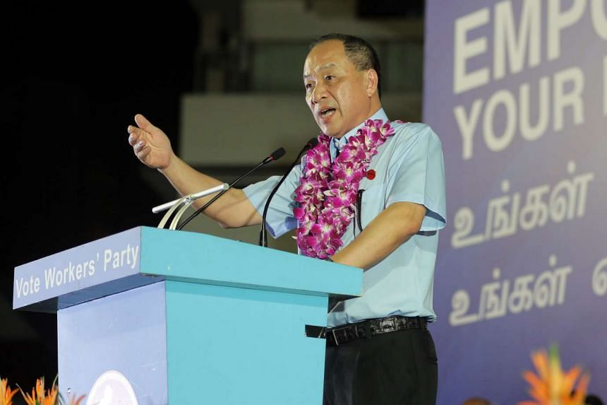 Workers' Party (WP) Secretary-General Low Thia Khiang speaking at a rally in front of Block 837 in Hougang Central on September 2, 2015.