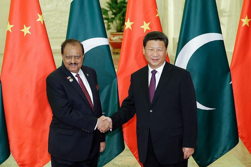 Chinese President Xi Jinping (right) shakes hands with Pakistan President Mamnoon Hussain at the Great Hall Of The People in Beijing on Sept 2, 2015.