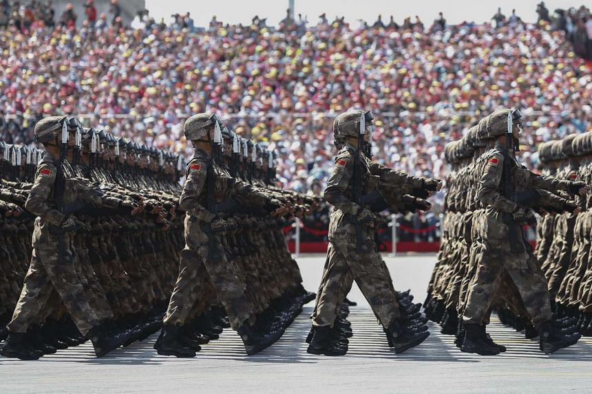 Chinese troops march during a military parade marking the 70th Anniversary of the 'Victory of Chinese People's Resistance against Japanese Aggression and World Anti-Fascist War' on Sept 3, 2015.