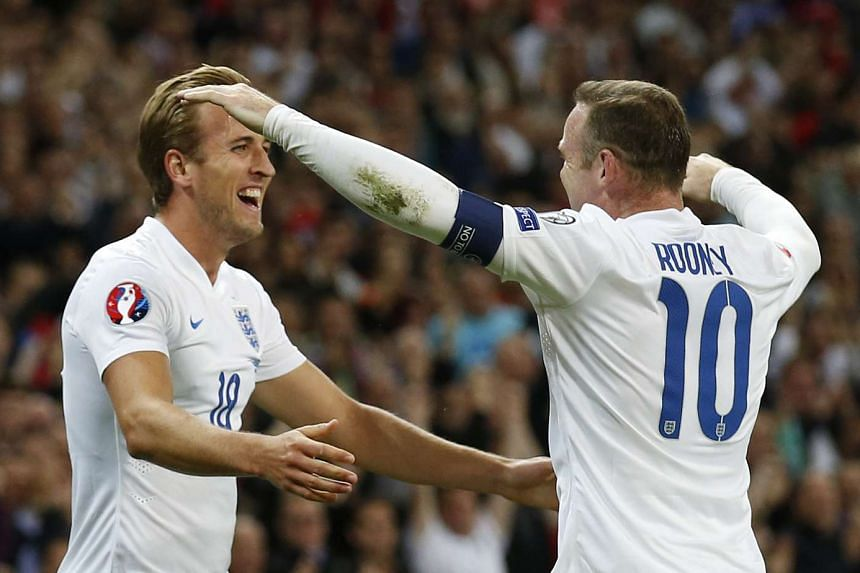 England's Harry Kane (left) celebrating with Wayne Rooney after scoring the first goal for England during their Euro 2016 Qualifying match against Switzerland at Wembley Stadium on Sept 8, 2015.