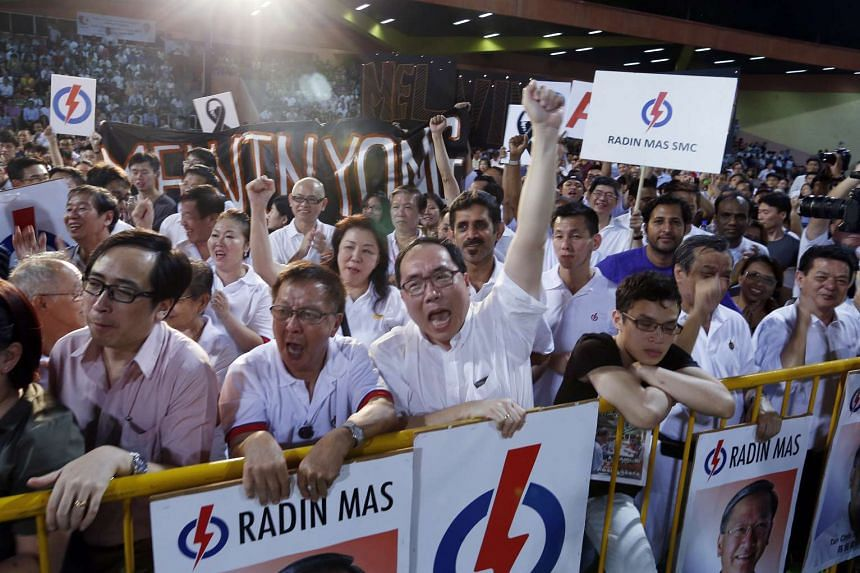 Supporters cheering at a People's Action Party (PAP) rally for Tanjong Pagar GRC and Radin Mas SMC held at Delta Hockey Pitch in Tiong Bahru on Sept 2, 2015, the first day of the rallies.