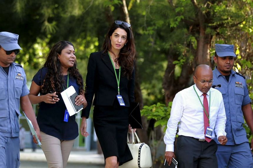 Amal Clooney (centre), lawyer of former Maldives president Mohamed Nasheed, leaves Maafushi prison after meeting Nasheed in the Maldives on Tuesday.