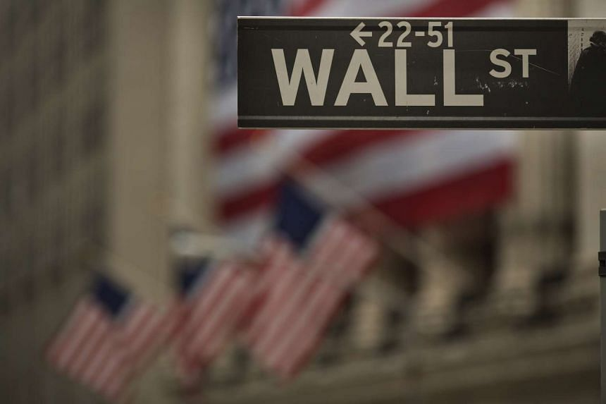 The Wall Street sign is seen outside of the New York Stock Exchange (NYSE) in New York.