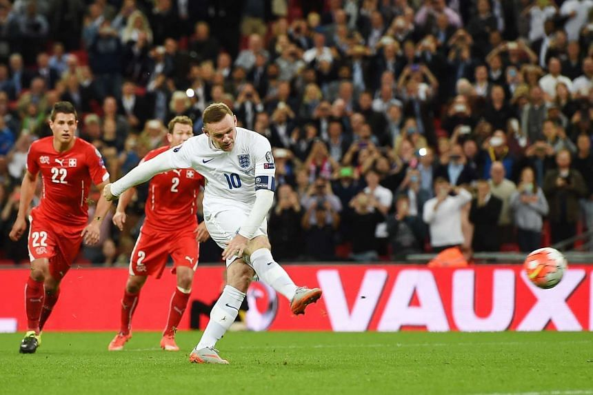 England's Wayne Rooney scores the 2-0 goal from the penalty spot during the UEFA EURO 2016 Group E qualification match between England and Switzerland, at Wembley Stadium in London on Tuesday. Rooney became England's all-time record goalscorer with 5