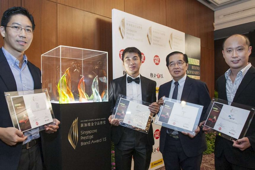 Winners all (from left): Mr Jate Samathivathanachai, director of beverage company Allswell (heritage brands category); Mr Francis Ng, chief executive of restaurant House of Seafood (promising brands category); Mr Tong Kok Kai, director of Chop Wah On