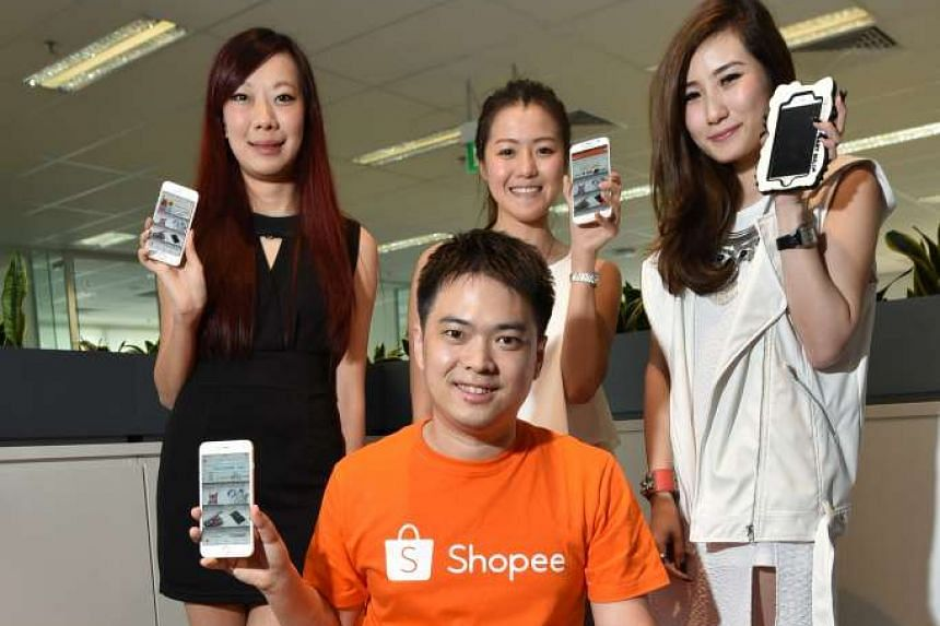 Shopee's chief executive, Mr Chris Feng, with (standing, from left) Ms Jessica Yeow of online cruelty-free cosmetics shop Jessilogy; Ms Paige Lim of online shoe shop Buckle Up; and Ms Keli Lim of online apparel shop Kikikeli.