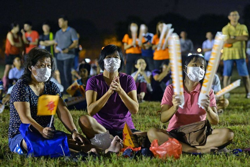 The haze, it would appear, is no barrier to attending a political rally - just wear a mask. A number of those who went for the NSP rally for Sembawang GRC at a field in Woodlands Drive yesterday did just that.