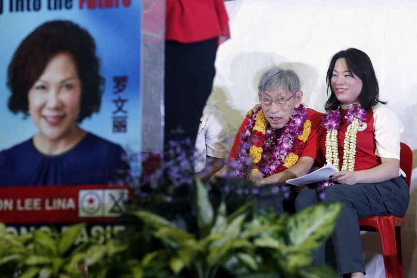 Mr Chiam See Tong and daughter Camilla listening as Mrs Lina Chiam speaks during the Singapore People's Party rally for Potong Pasir SMC held at Potong Pasir Avenue 1.
