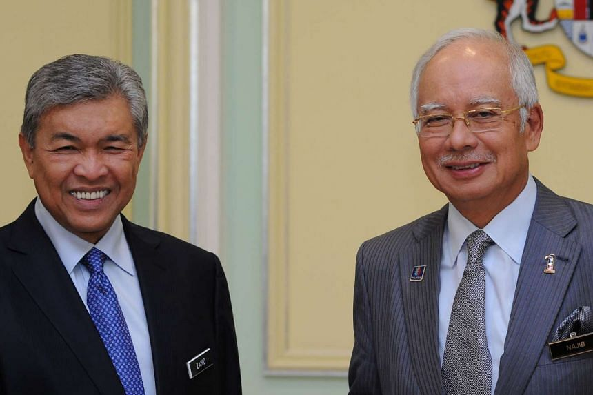 Malaysia's Prime Minister Najib Razak (right) with Deputy Prime Minister Ahmad Zahid Hamidi after addressing a press conference at the Prime Minister's office in Putrajaya on July 28, 2015.
