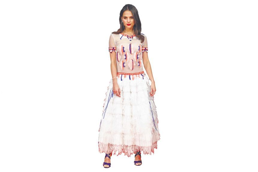 This fringe and tribal frock from Chanel is one of the actress' more daring sartorial choices yet, but she tones it down with matching blue heels.