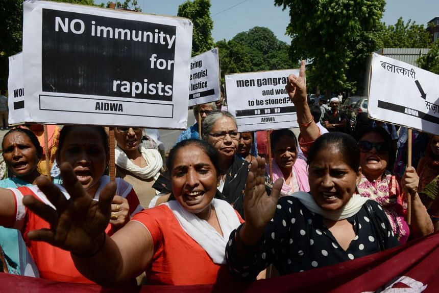 Indian women shout slogans and hold placards during a protest against the rape of two Nepalese women by a Saudi diplomat, near the Saudi Arabian embassy in New Delhi on Sept 10, 2015.