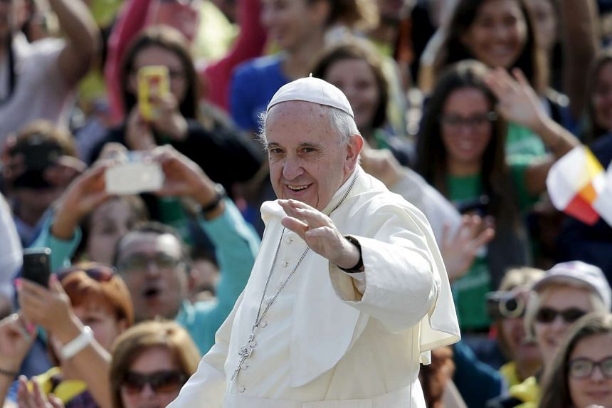 Pope Francis waving to the crowd at Saint Peter's Square on Sept 9.