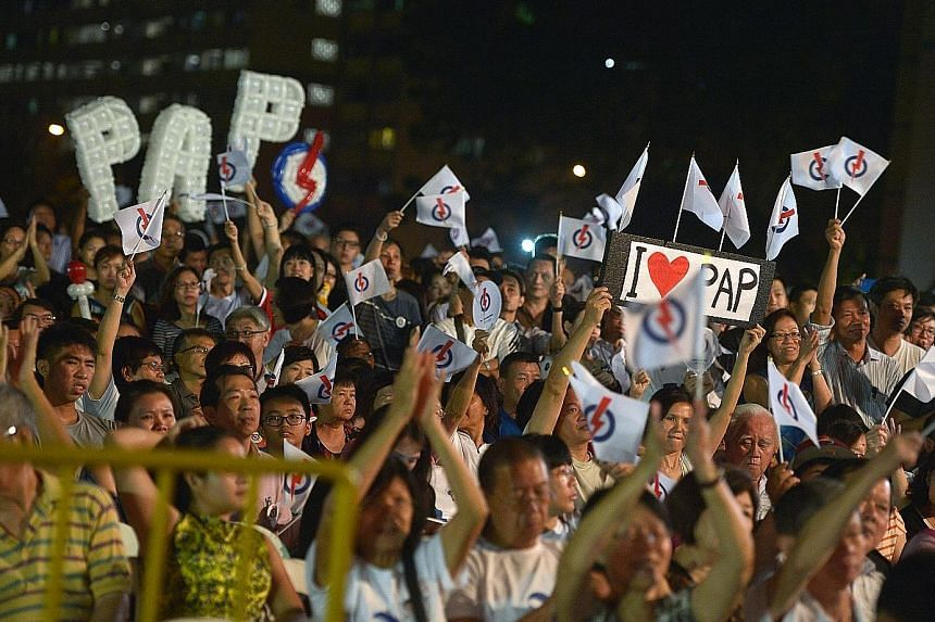 PAP supporters attending the party's rally for East Coast GRC, held in Simei, last night. Strong leadership today is different from strong leadership 20 or 30 years ago, said Deputy Prime Minister Tharman Shanmugaratnam, adding that a changed PAP is