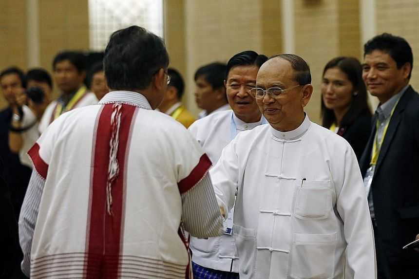 Myanmar President Thein Sein (facing camera) greeting a member of an ethnic rebel team, before meeting leaders of ethnic armed groups yesterday to discuss the signing of a nationwide ceasefire deal.