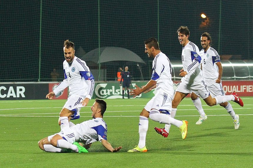 San Marino's Matteo Vitaioli (on ground) celebrating after scoring against Lithuania but the minnows could not hold on for a rare draw.
