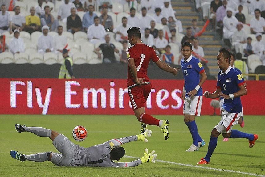 Malaysia (in blue) found themselves outclassed 0-10 by the United Arab Emirates in a World Cup qualifier in Abu Dhabi last week. The record loss has triggered demands for a major revamp.